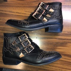 Black booties with gold detail